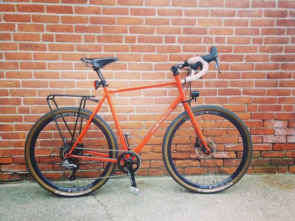 Pioneer Valley Frameworks Hilltown all road D2R2 Western Massachusetts dirt road riding bike custom bicycle handmade generator hub 650b 700c Velocity Ailerons Brooks Leather Saddle Tubus Rack steel fork SRAM Force Single Ring disc brake lightweight adventure gravel do everything all terrain bikePicture