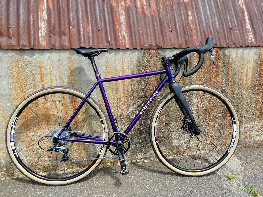 Pioneer Valley Frameworks custom cyclocross bike gravel bike race bike bicycle handmade handbuilt Look Park CX cross Massachusetts made Western Massachusetts New England custom bike Stan's Crests SRAM Rival single ring woman's bike women's cx bike ENVE fork purplePicture